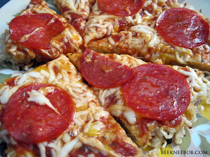 a picture of pizza made from Ramen noodles topped with sauce, cheese, and pepperoni